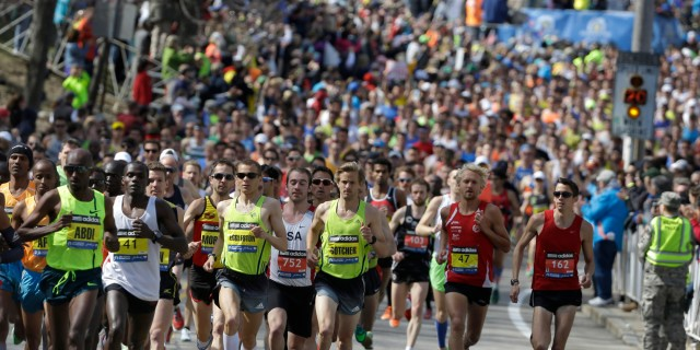 Runners run along the route of the 118th Boston Marathon Monday, April 21, 2014, in Hopkinton, Mass. (AP Photo/Steven Senne)
